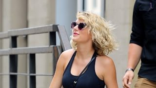 Taylor Swift Sports a Smile Following Her Split With Tom Hiddleston