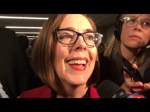Kate Brown talks to reporters after re-election