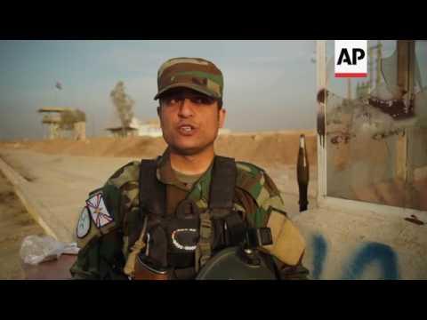 Christian militia patrol Iraq city taken from IS