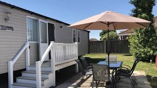 Hopton holiday village stunning caravan with outside seating available for summer holidays.