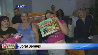 Big Bus Toy Express: Crowd Lines Up To Make Donations In Coral Springs