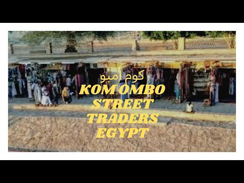 Watching the Egyptian street traders at Kom Ombo, Egypt.