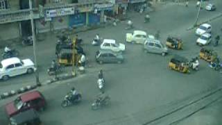 India Driving(A very funny look at how people drive in india. The rules are quite different there. Watch the white car in the top center going against traffic., 2006-03-22T02:01:08.000Z)