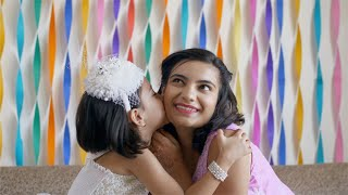 Sweet little Indian girl / kid is hugging and kissing her beautiful mother - Decoration at home