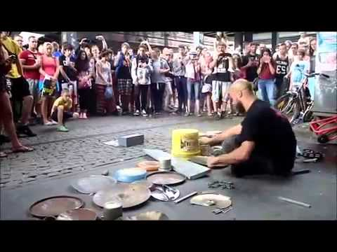 Guy drumming on some buckets, pots and pans makes a technoparty in the streets