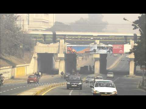 Steam engine train passing over a bridge in Sarojini Nagar, New Delhi