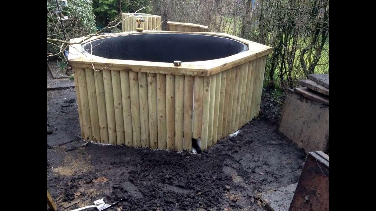 How to build wooden raised koi fish pond construction for Wooden koi pool