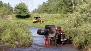 Louie puts the Polaris RZR 900XP on its side in a swamp.  PowerModz!