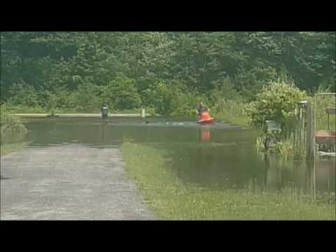 Midland residents use watercraft in flooded backyard