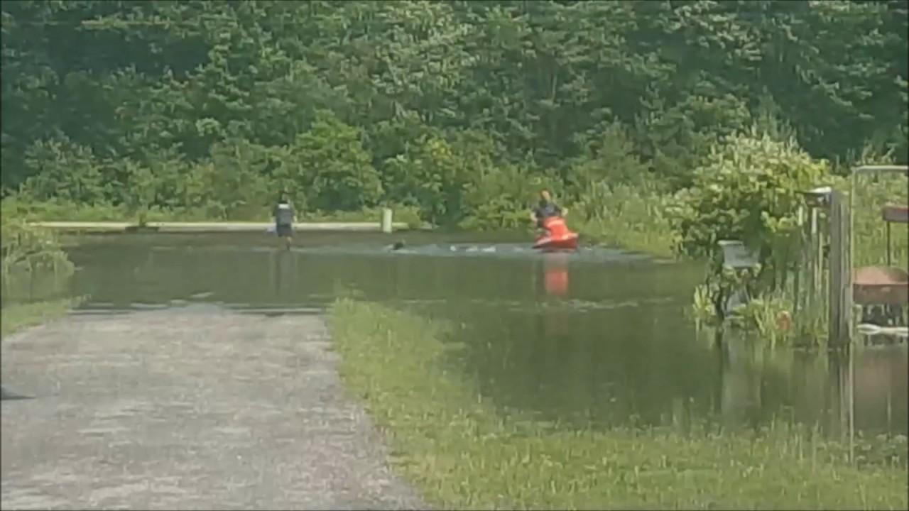 midland residents use watercraft in flooded backyard youtube