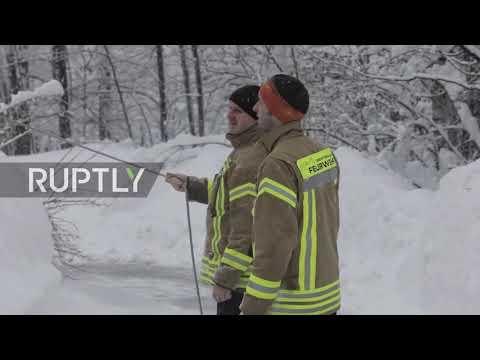 Germany: Buchenhoehe cut off as snow blankets Bavaria