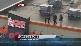 Cops on roofs in Milwaukee