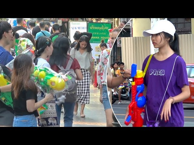 Tourists Buy Water Guns And Floral Shirts For Songkran