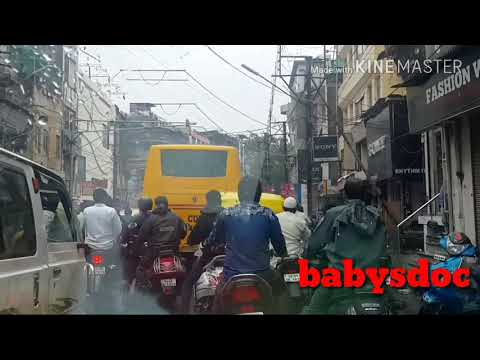 Traffic and rainy weather on Khajuri Bazar Street at Indore Madhya Pradesh