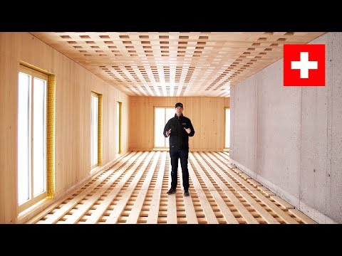 This Swiss Building blew me away!  All Wood and Concrete - NO Insulation