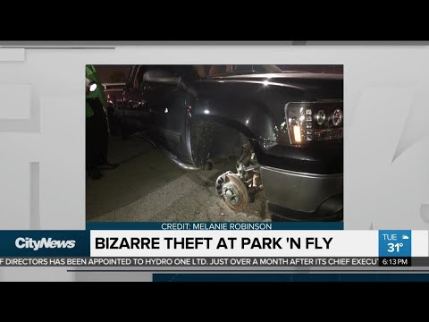 Vehicle Stripped Of Tires And Rims At Park 'N Fly Lot