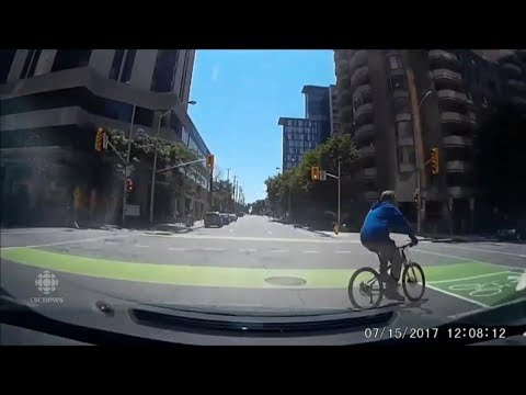 Cyclist survives dramatic collision caught on camera