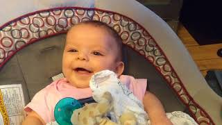 Lillian laughs during peek a boo