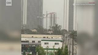 Construction cranes spin from Irma winds