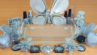 Slime Silver Mixing makeup and glitter into Clear Slime