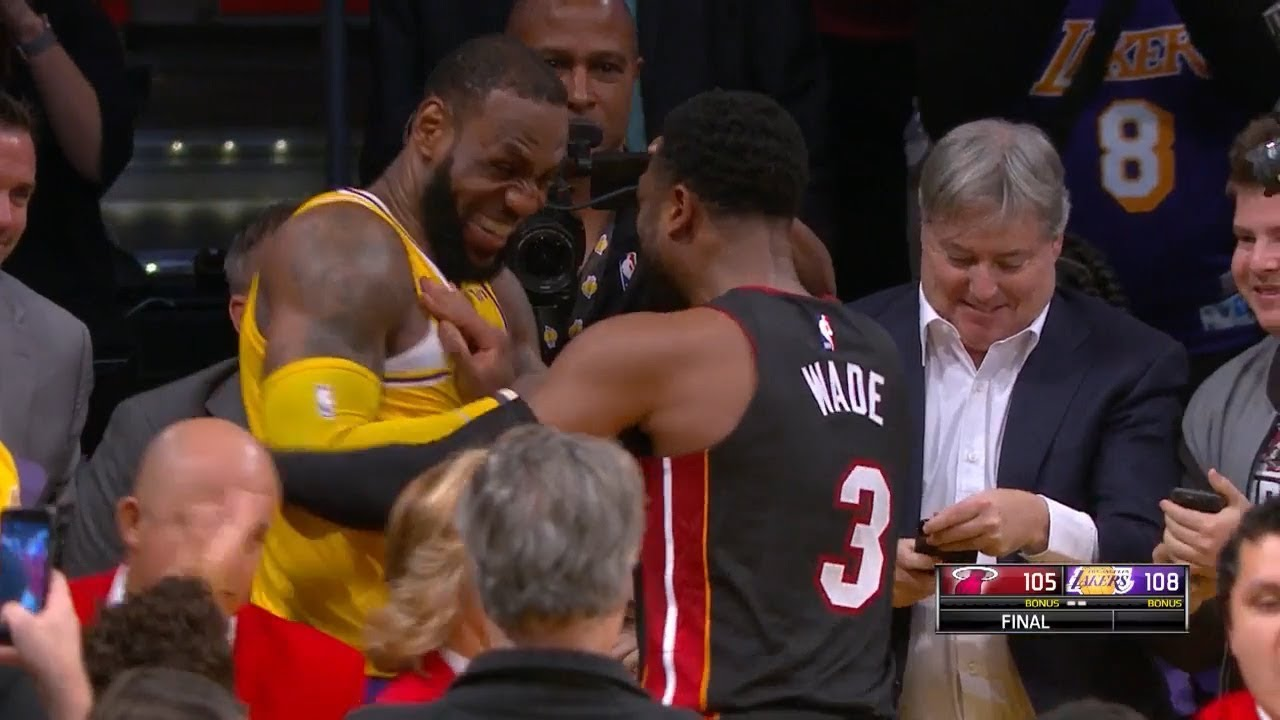 a42a72ce763a LeBron   Dwyane Wade Exchange Jerseys at the End of the Game - Final Game