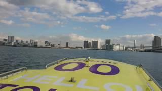 Twin water taxis run through Tokyo harbor