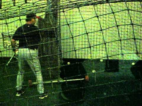 Joe Mauer receiving instruction from Twins hitting coach under AT&T Park