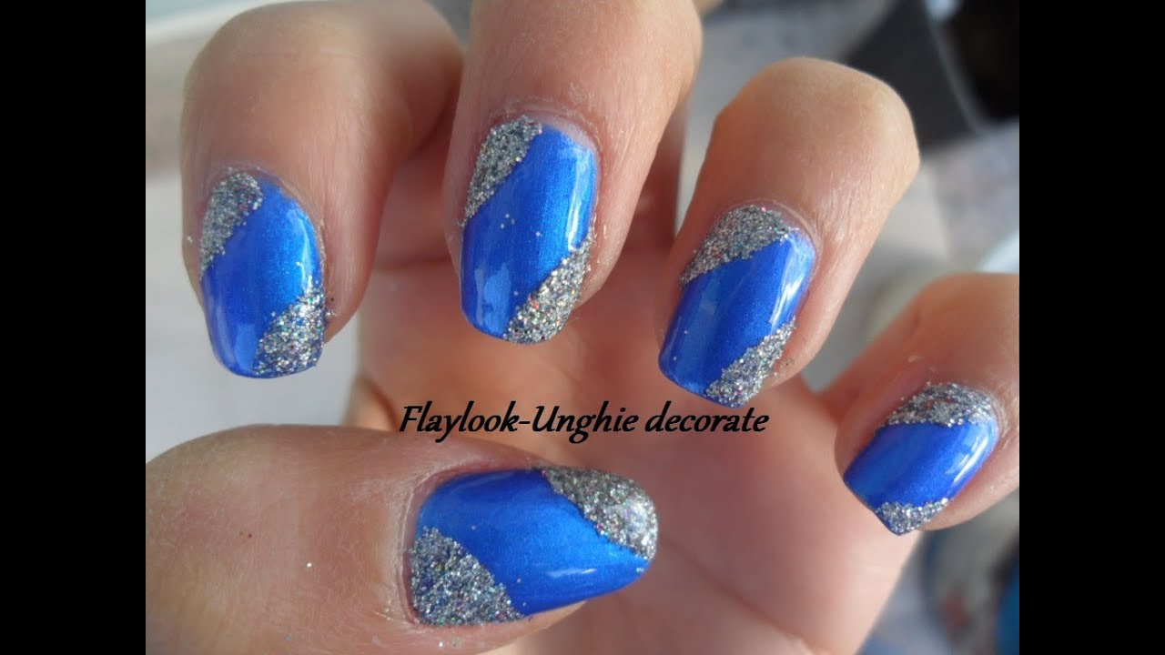 Video tutorial 36 nail art natalizia con smalto blu elettrico e glitter  argentati, By Flaylook