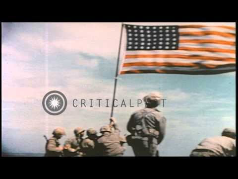 US Marines raise American flag on top of Mount Suribachi in Iwo Jima, Japan durin...HD Stock Footage