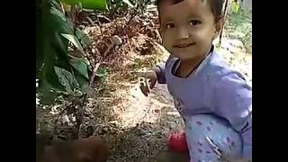 Cutest baby girl playing with puppies/lots of fun/beauty of childhood/kids fun