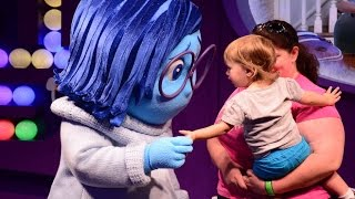 Joy and Sadness from Inside Out meet guests at Epcot's Character Spot