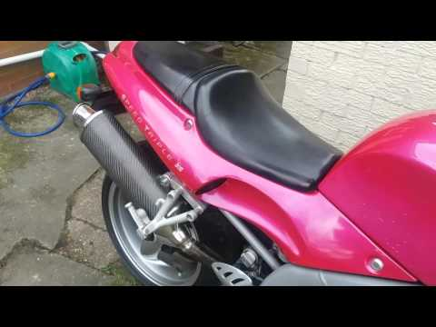 Triumph 955I speed triple nuclear red carbon high level exhaust flames sound