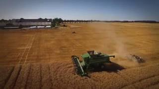 Video John Deere T670 combine pulling a disc harrow while harvesting download MP3, 3GP, MP4, WEBM, AVI, FLV Desember 2017