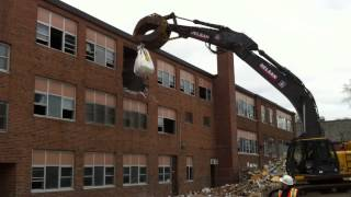 SJE School Demo - Dragging out a bag of asbestos tile