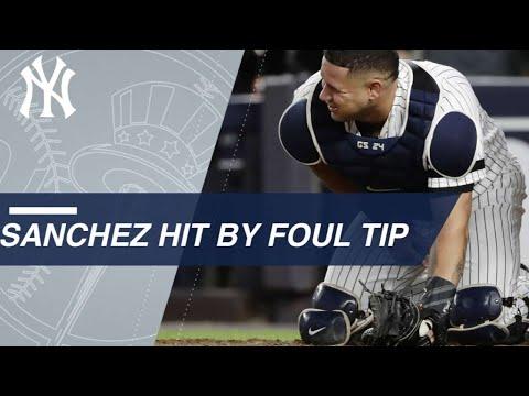 AL WC: Sanchez hit hard on foul tip, stays in game