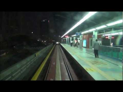 LRT ride in Kuala Lumpur from KL Sentral Station to KLCC at night to see Petronas Towers, Malaysia