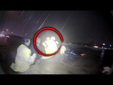 Lance Houston - WATCH: Police Form Human Chain to Rescue Family from Floodwaters