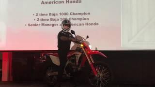 Sr. Honda Manager Chuck Miller rides 2019 CRF450L on stage