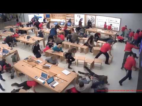 Surveillance video shows chaos as shooting erupts outside Apple store