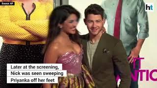Watch  Nick Jonas sweeps wife Priyanka Chopra off her feet   video dailymotion