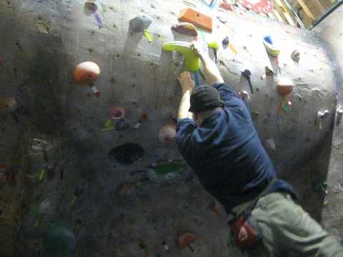 Michael Johnson almost climbs a V2 at the Alaska Rock Gym