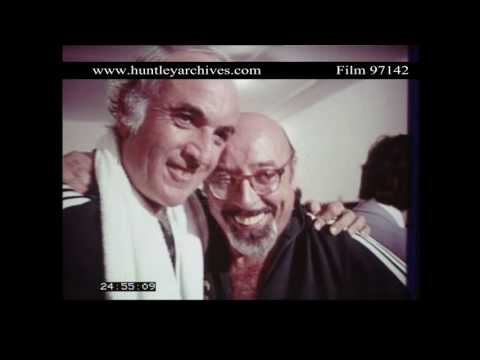 Steve Ross hugs Ahmet Ertegun.  Archive film 97142