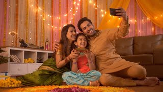 Diwali festival - Indian lovable family taking selfie or self photograph at home. Colorful decorate background