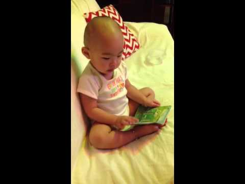 18 month old talking gibberish while reading a book