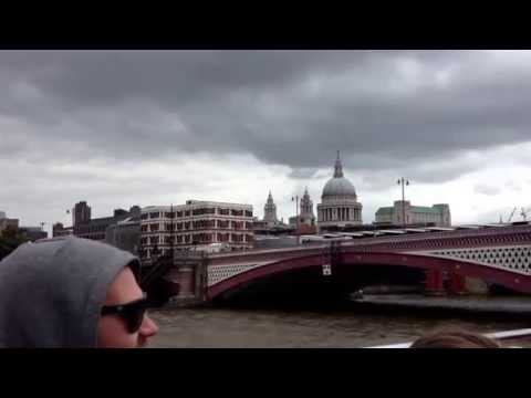 Tour guide on Thames sightseeing cruise, London