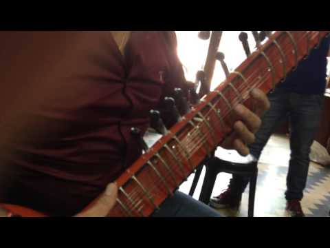 Ajay at Riki Ram indian music instrument shop play his new Electric sitart