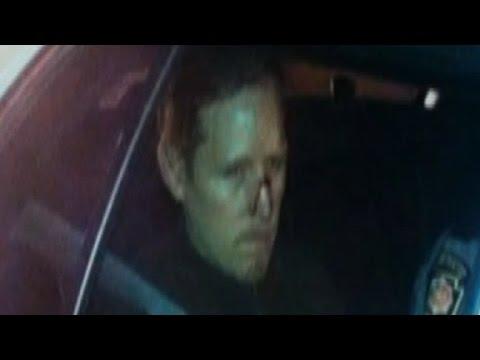 New image of suspect in custody