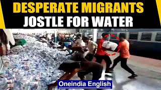 In heart wrenching video, desperate migrants seen looting water bottles | Oneindia News