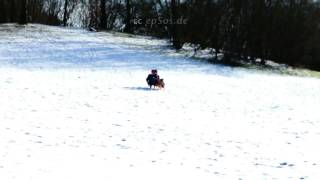 Cute Children Have Winter Sled Fun In Snow Of Europe