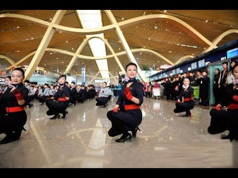 Chinese Flight Attendants Flash Dance At Shanghai Airport